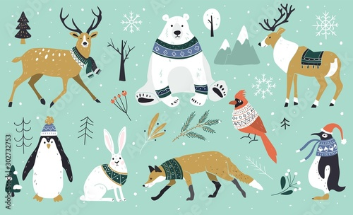 Set of Christmas animals in the forest, bear, fox, hare, reindeer, penguin. Scandinavian style.Winter animals in a sweater and scarfs. Hand drawn characters cartoon flat design.