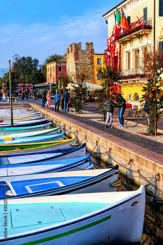 Fototapety, obrazy: View of Bardilino at the lakeside of Lake Garda in summer in the northern Italy. The town is a popular holiday destination in lake Garda district.