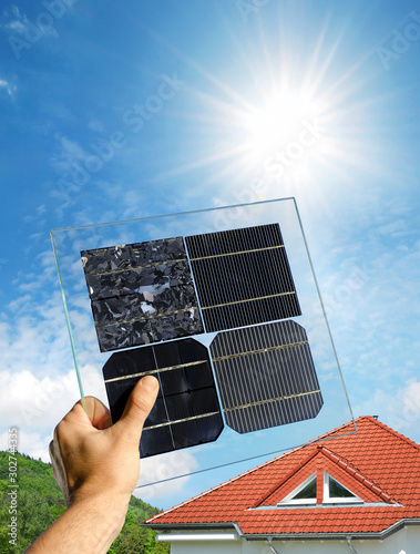 Hand holding samples of various solar cells of polycrystalline and monocrystalline types #302744335