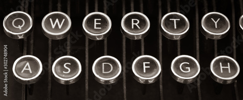 Photo Old Vintage typewriter keys close up Letters QWERTY and ASDFGH