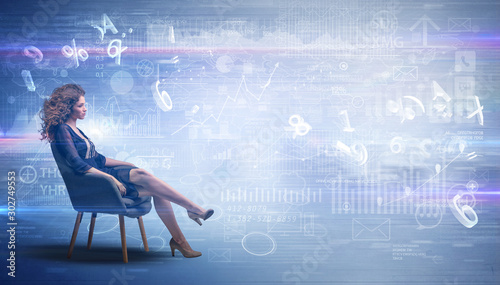 Fotomural  Elegant woman sitting in a sofa with numbers and reports concept