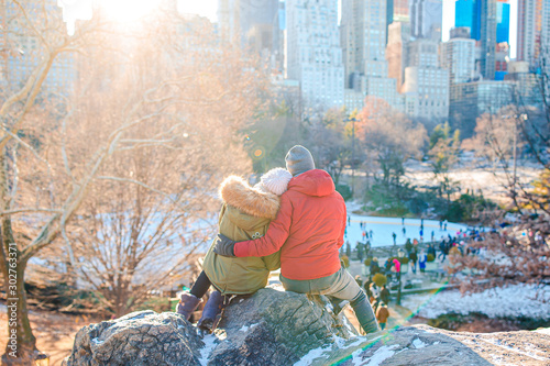 Fototapeta Happy couple enjoy the view of famous ice-rink in Central Park in New York City obraz