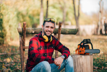 Portrait Of A Smiling Young Lumberjack.