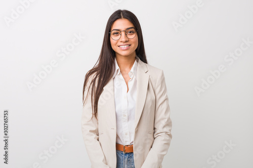 Young business arab woman isolated against a white background happy, smiling and cheerful Wallpaper Mural