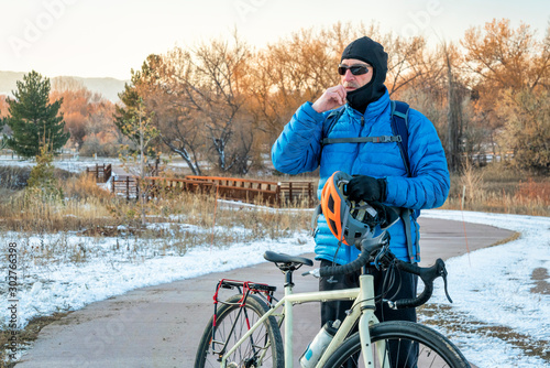 putting balaclava and helmet on for winter biking Canvas Print