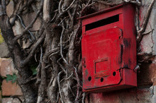 Red Old Mailbox On The Wall. Letter Boxes.