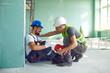 Leinwanddruck Bild - Construction worker accident with a construction worker.