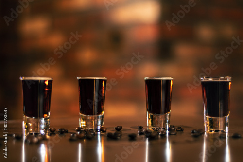 Poster de jardin Alcool four alcohol coffe shot and coffee beans on the wooden table