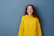 canvas print picture - Joyful young redhead woman laughing at camera