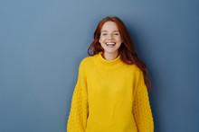 Joyful Young Redhead Woman Lau...
