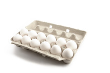 A Dozen Eggs In A Cardboard Carton Isolated On White