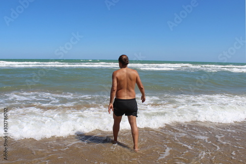 Turista al mare in vacanza Tapéta, Fotótapéta