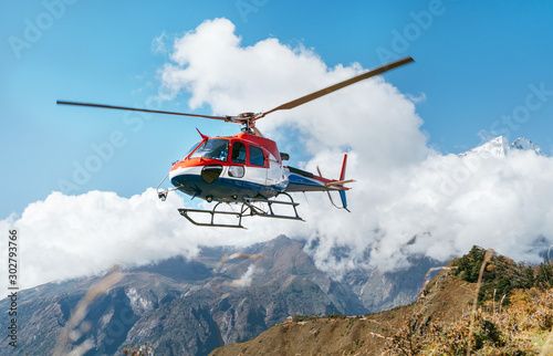 Fototapeta Medical Rescue helicopter landing in high altitude Himalayas mountains