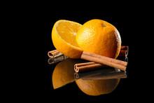 Oranges And Cinnamon On Mirror Background