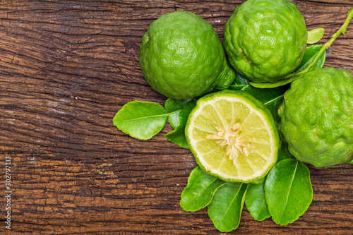 Fresh bergamot fruit with bergamot leaves on old wooden background Wallpaper Mural
