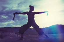 Shamanic Movement Woman On Big Boulders Desert Twilight Qi Gong.  Shamanic Tai Chi
