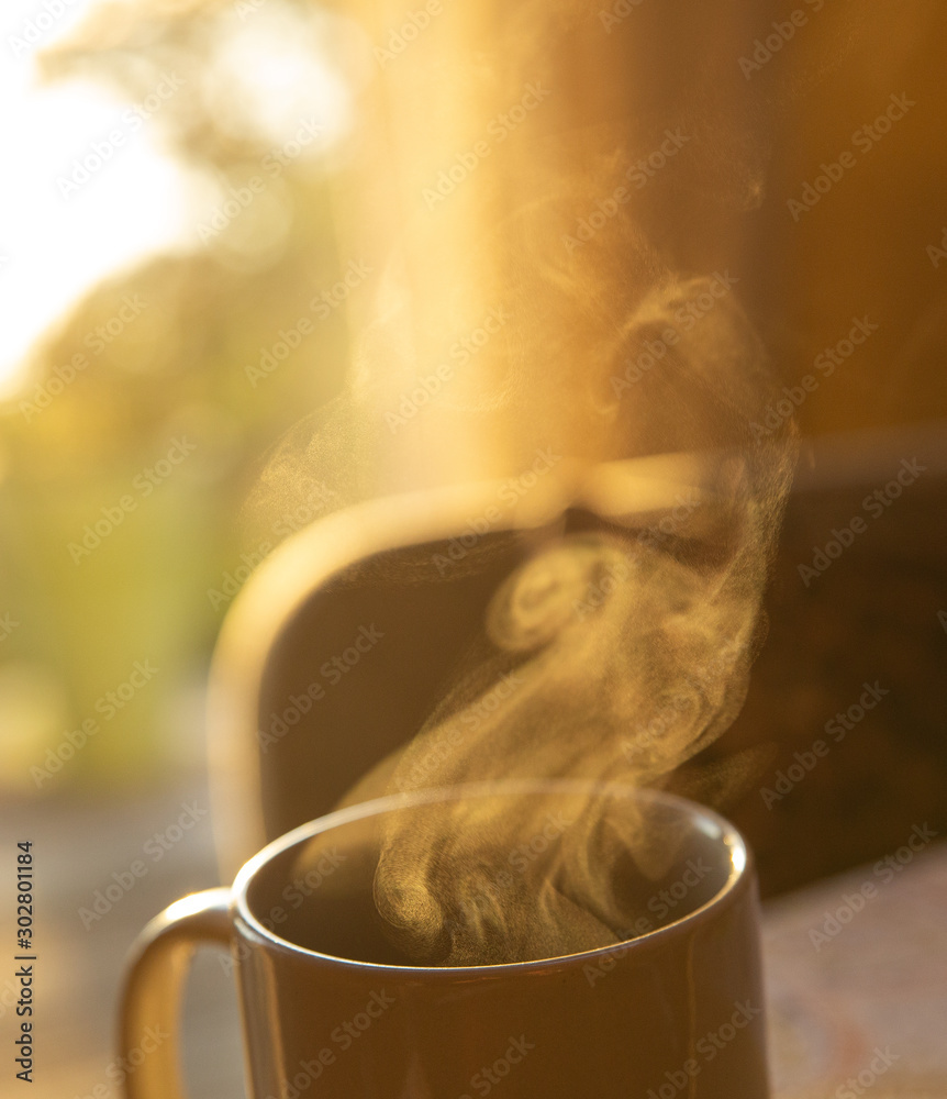 Fototapety, obrazy: Steam coming from morning mug of coffee