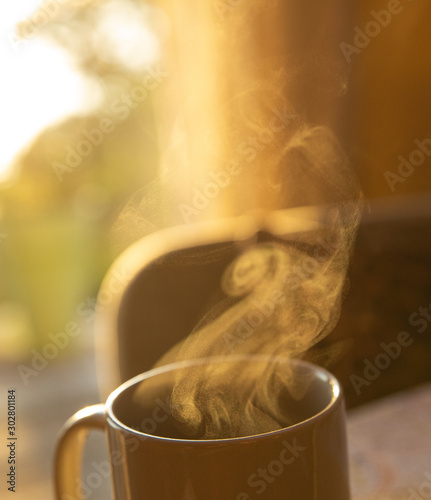 Foto auf AluDibond Kaffee Steam coming from morning mug of coffee