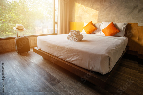 The comfortable hotel bedroom in cozy style. Conceptual of interior design in hotel.