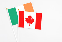 Canada And Ireland Stick Flags On White Background. High Quality Fabric, Miniature National Flag. Peaceful Global Concept.White Floor For Copy Space