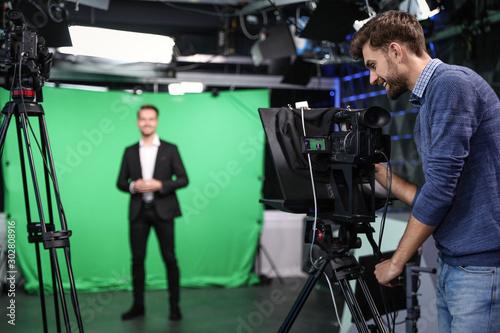 Fotografia, Obraz Presenter and video camera operator working in studio