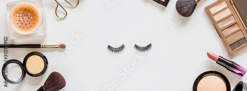 Photo Make up items on white background with copy space