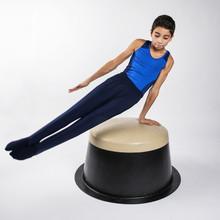 Male Child Gymnast Practicing ...