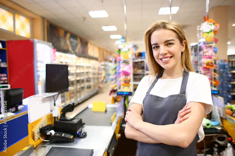 Fototapeta Portrait of female cashier in supermarket