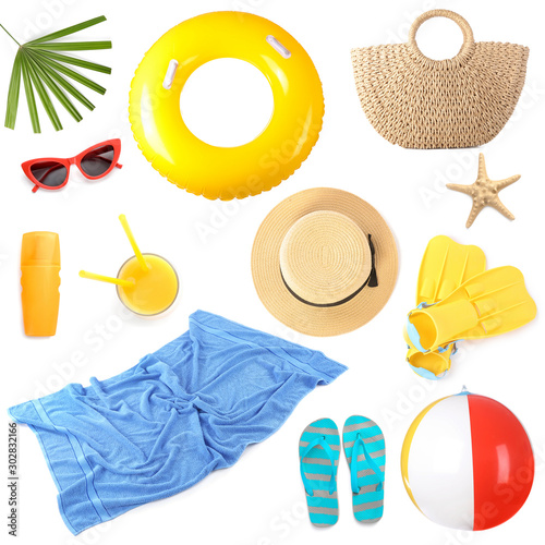 Photo Set of beach accessories on white background