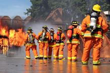 Firemen Wearing Fire Fighter S...
