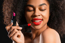 Portrait Of Beautiful African-American Woman With Bright Lipsticks On Dark Background, Closeup