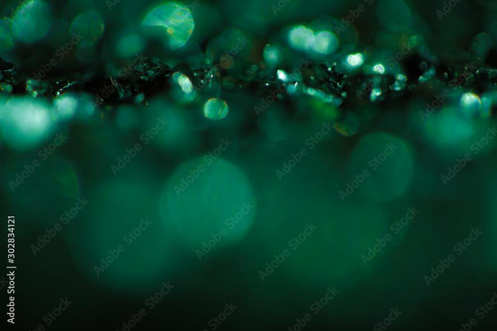 Fototapeta Monochrome emerald abstract background with bokeh defocused lights.