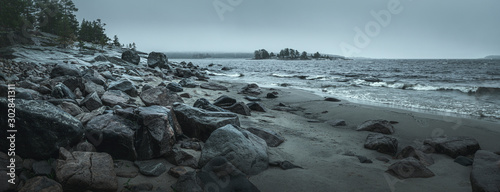 Panorama of a rocky shore. Overcast day. Background for travel materials