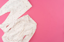 Baby Clothes On Pink Backgrou...