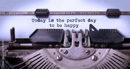 Today is the perfect day to be happy, written on an old typewriter