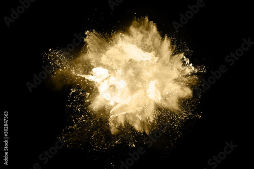 Obraz na plátně  Golden powder explosion on black background. Freeze motion.