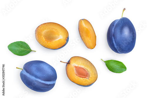 fresh blue plum and half with leaves isolated on white background. Top view. Flat lay