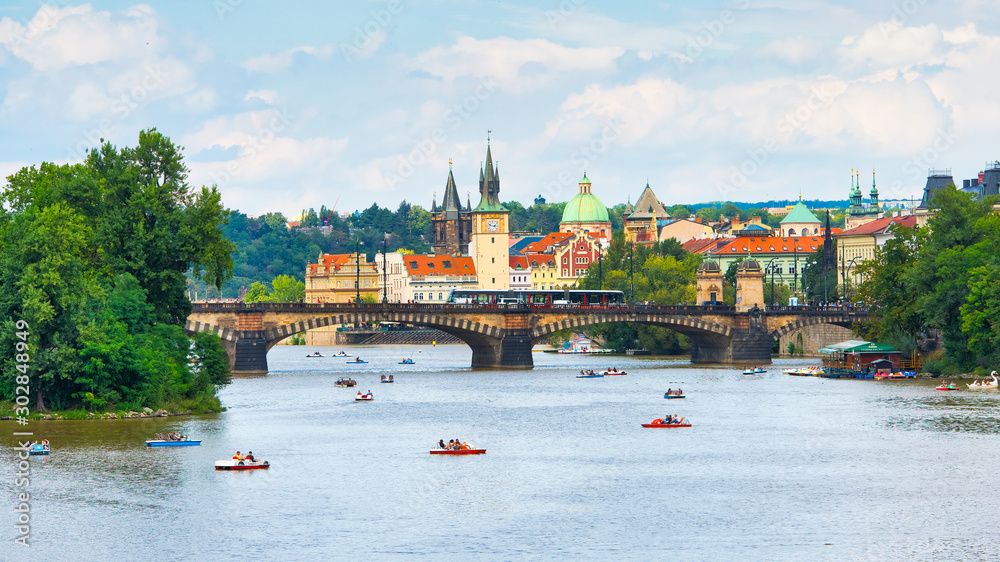 Fototapety, obrazy: Tourists with pedaloes on the Vltava river in Prague