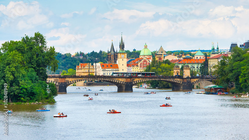 Tourists with pedaloes on the Vltava river in Prague Canvas Print