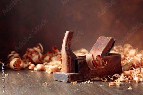 Fotografie, Obraz  Old wooden jointer and shaving on wooden table.