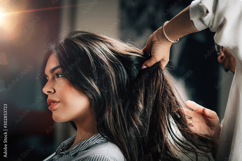 Fototapety, obrazy: Hairstylist Fixing Woman's Hair