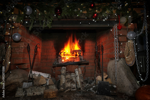 decorated christmas fireplace at night Fototapet