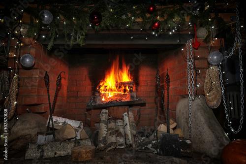 Obraz decorated christmas fireplace at night - fototapety do salonu