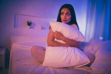 Portrait Of Her She Nice Attractive Scared Horrified Brunet Girl Hugging Pillow Sitting On Bed Waiting Husband Boyfriend Partner At Night In Illuminated Room House Hotel Indoors