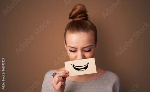 Person holding card in front of his mouth with ironic smile фототапет