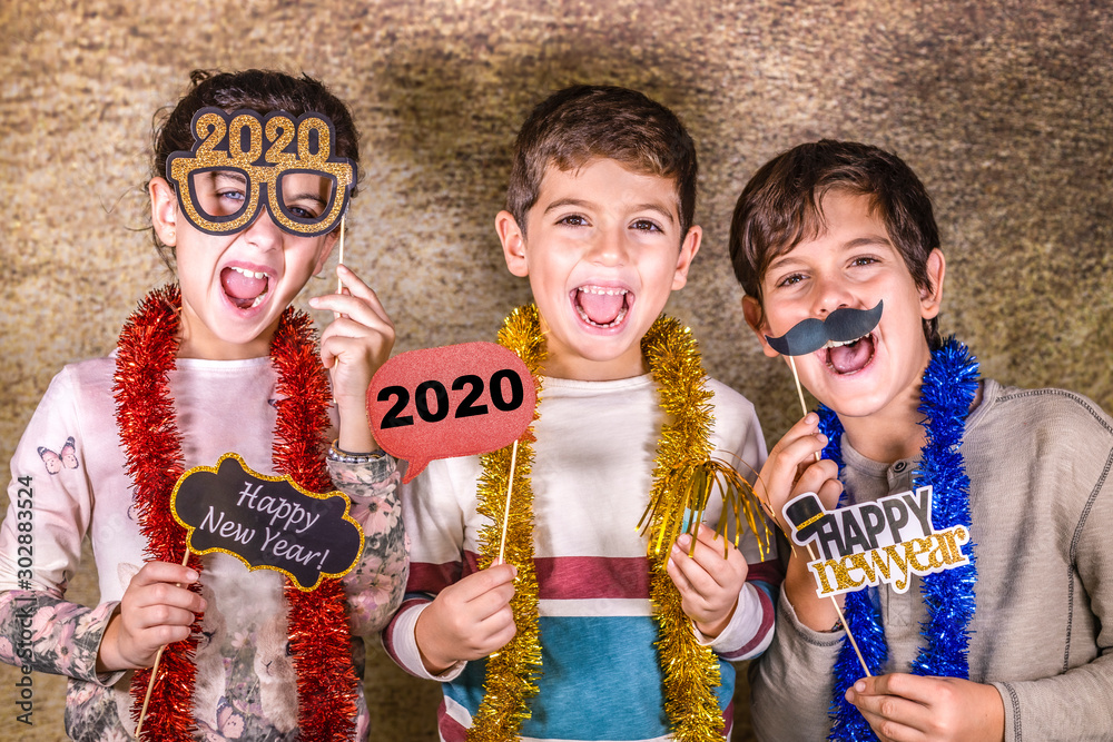 Fototapety, obrazy: Three kids celebrating New Years Eve. 2020!