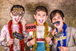 canvas print picture - Three kids celebrating New Years Eve. 2020!