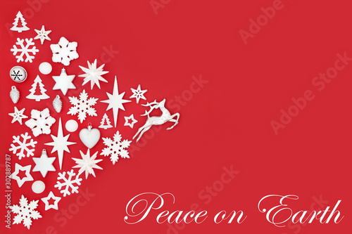 Photo Stands Roe Christmas peace on earth abstract background with white and silver tree decorations and symbols on red with copy space. Traditional theme for the festive season.