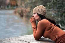 Sad Woman Looking Towards A Lake