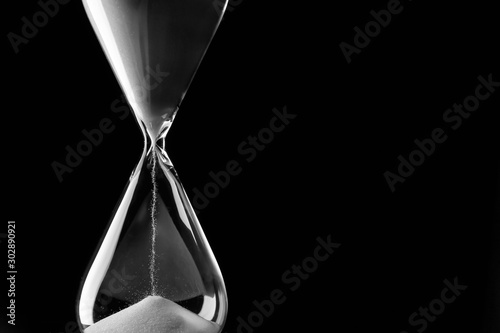 Fotografie, Obraz  Crystal hourglass on dark background
